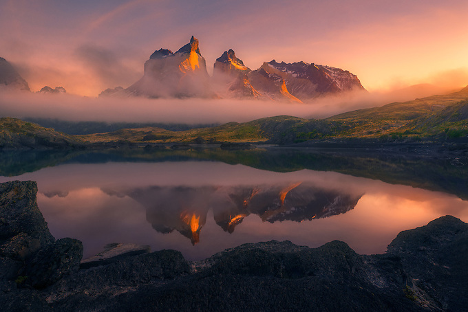 Los Cuernos del Paine peeks through low clouds and fog, illuminated by the rising sun.  Just moments later, a heavy fog came through as the scene vanished into the light of day.<br /> Artist Edition: 15/200 Limited