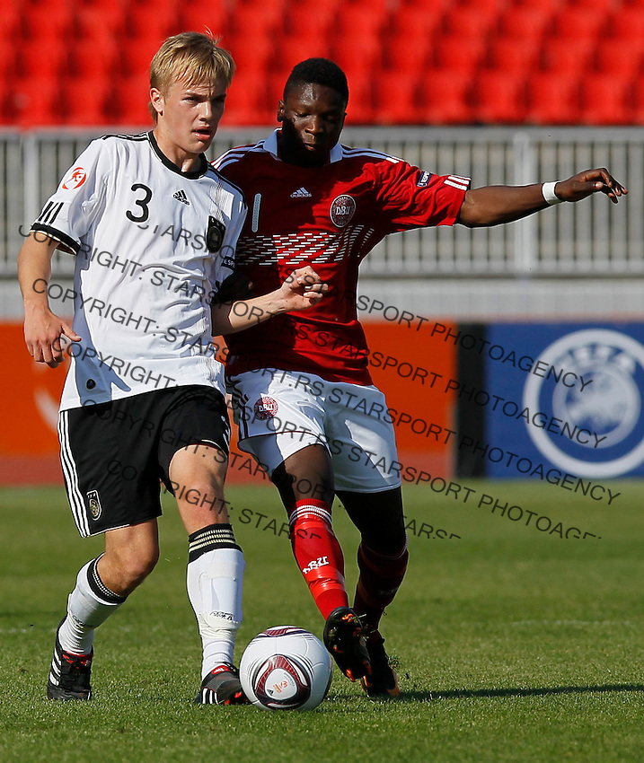 Cimo Rocker (L) of Germany battles for the ball with Kenneth Zohore of Denmark during the UEFA U17 Championships Semi Final match between Denmark and Germany on May 12, 2011 in Novi Sad, Serbia. (Photo by Srdjan Stevanovic/Starsportphoto.com)