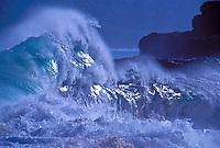 Storm waves crashing along coastline, Kauai
