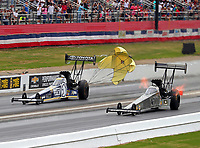 May 5, 2018; Commerce, GA, USA; NHRA top fuel driver Antron Brown (left) races alongside Tony Schumacher during qualifying for the Southern Nationals at Atlanta Dragway. Mandatory Credit: Mark J. Rebilas-USA TODAY Sports