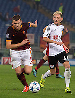 Calcio, Champions League, Gruppo E: Roma vs Bayer Leverkusen. Roma, stadio Olimpico, 4 novembre 2015.<br /> Roma's Edin Dzeko, left, is chased by Bayer Leverkusen's Kevin Kampl during a Champions League, Group E football match between Roma and Bayer Leverkusen, at Rome's Olympic stadium, 4 November 2015.<br /> UPDATE IMAGES PRESS/Riccardo De Luca