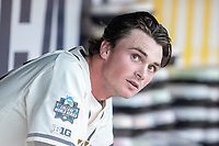 Michigan Wolverines pitcher Tommy Henry (47) in the dugout against the Vanderbilt Commodores during Game 1 of the NCAA College World Series Finals on June 24, 2019 at TD Ameritrade Park in Omaha, Nebraska. Michigan defeated Vanderbilt 7-4. (Andrew Woolley/Four Seam Images)