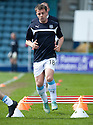 From avoiding being behind bars to jumping them, Dundee's Paul McGowan warms up before the game.