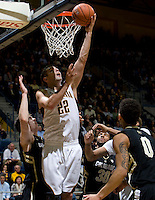 Harper Kamp of California tosses the ball into a basket during the game against Colorado at Haas Pavilion in Berkeley, California on January 12th, 2012.   California defeated Colorado, 57-50.