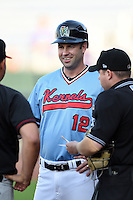 Cedar Rapids Kernels manager Jake Mauer (12) during the lineup exchange before a game against the Quad Cities River Bandits on August 19, 2014 at Perfect Game Field at Veterans Memorial Stadium in Cedar Rapids, Iowa.  Cedar Rapids defeated Quad Cities 5-3.  (Mike Janes/Four Seam Images)