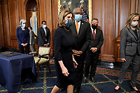 Speaker of the United States House of Representatives Nancy Pelosi (Democrat of California) leaves an engrossment ceremony for H.R. 24, an article of impeachment against President Donald Trump, with US House Majority Whip James Clyburn (Democrat of South Carolina) on Wednesday, January 13, 2021 at the U.S. Capitol.<br /> Credit: Greg Nash / Pool via CNP /MediaPunch