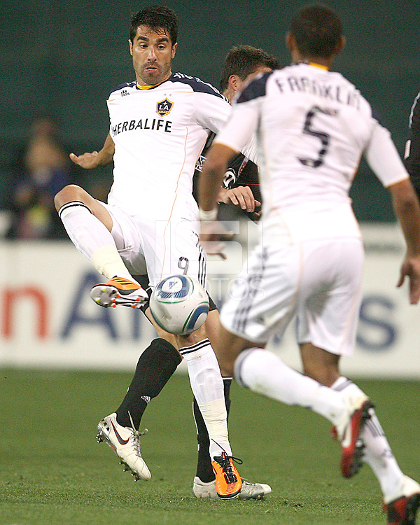 Juan Pablo Angel (9) of the Los Angeles Galaxy pushes the ball towards Sean Franklin (5) during an MLS match against D.C. United at RFK Stadium, on April 9 2011, in Washington D.C. The game ended in a 1-1 tie.