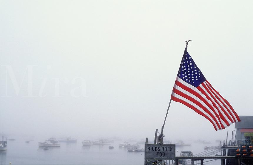 USA, Maine, Stonington, US flag on  fishing pier in fog