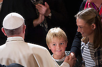 Papa Francesco saluta alcuni bambini  al suo arrivo alla Chiesa Evangelica Luterana di Roma, 15 novembre 2015.<br /> Pope Francis greets some children as he arrives to visit the Lutheran Evangelical Church in Rome, 15 November 2015.<br /> UPDATE IMAGES PRESS/Riccardo De Luca<br /> <br /> STRICTLY ONLY FOR EDITORIAL USE