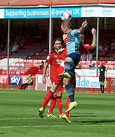Garry Thompson of Wycombe Wanderers wins the header during the Sky Bet League 2 match between Crawley Town and Wycombe Wanderers at Broadfield Stadium, Crawley, England on 6 August 2016. Photo by Alan  Stanford / PRiME Media Images.