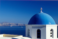 church, Santorini, Greek Islands, Oia, Cyclades, Greece, Europe, Whitewashed church with blue dome in the village of Oia overlooking the Aegean Sea on the island of Santorini.