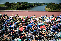 peloton crossing the Maas/Meuse River<br /> <br /> 17th Benelux Tour 2021<br /> Stage 5 from Riemst to Bilzen (BEL/192km)<br /> <br /> ©kramon