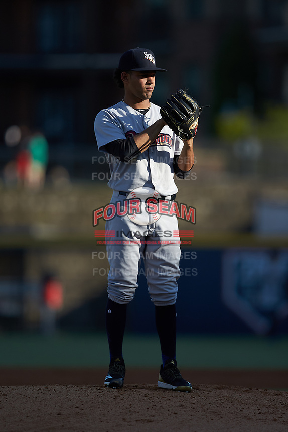 Scranton/Wilkes-Barre RailRiders starting pitcher Deivi Garcia (4) looks to his catcher for the sign against the Gwinnett Stripers at Coolray Field on August 18, 2019 in Lawrenceville, Georgia. The RailRiders defeated the Stripers 9-3. (Brian Westerholt/Four Seam Images)
