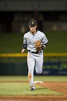 Salt River Rafters shortstop Bryson Brigman (15), of the Miami Marlins organization, jogs off the field between innings of an Arizona Fall League game against the Mesa Solar Sox at Sloan Park on October 16, 2018 in Mesa, Arizona. Salt River defeated Mesa 2-1. (Zachary Lucy/Four Seam Images)