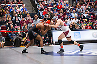 STANFORD, CA - March 7, 2020: Devan Turner of Oregon State University and Paul Bianchi of Little Rock during the 2020 Pac-12 Wrestling Championships at Maples Pavilion.