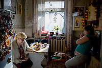 Svetlana Vishniakova (left) was the school mistress in Chilchi but since she had a stroke her right side is paralyzed and she can't speak. Her daughter-in-law cares for her.