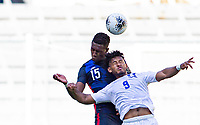 GUADALAJARA, MEXICO - MARCH 28: Andres Perea #15 of the United States with a clearing head ball during a game between Honduras and USMNT U-23 at Estadio Jalisco on March 28, 2021 in Guadalajara, Mexico.