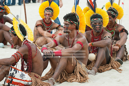 Pataxo indigenous people from the Brazilian state of Bahia are forming a line, sitting on the beach, as part of the Human Banner to protest about the construction of hydroelectric dams on Brazil's rivers.The People's Summit at the United Nations Conference on Sustainable Development (Rio+20), Rio de Janeiro, Brazil, 19th June 2012. Photo © Sue Cunningham.