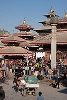 Kathmandu, Nepal.  Durbar Square   Crowd listening to a speaker under King Pratap Malla's Column on right, Jagannath Temple behind.