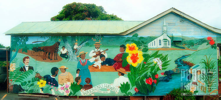 A painted mural of island life in the late 19th century on the side of a store in Waiohinu, Big Island of Hawai'i.