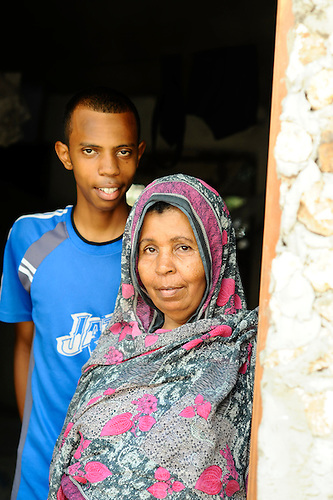 Student portraits with families in their modest homes - Likoni, Kenya.