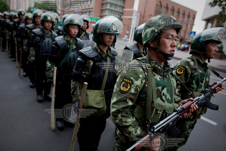 Security forces patrol following unrest after Friday prayers in Urumqi. Due to the recent ethnic violence, Chinese authorities had tried to stop Friday prayers going ahead but at the last minute the doors to the mosque were opened.