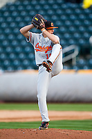 Blake Barnes (16) of the Oklahoma State Cowboys winds up during a game against the Missouri State Bears at Hammons Field on March 6, 2012 in Springfield, Missouri. (David Welker / Four Seam Images)