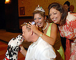 Shelby Kibodeaux gets a kiss from Trevor while his friends Any Walther and Jennifer Howard joke around at the Citizens for Animal Protection owner/pet fashion show at the Hilton Americas Houston Saturday June 06,2009.(Dave Rossman/For the Chronicle)