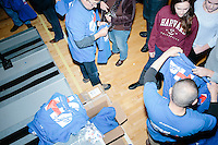 Volunteers hand out t-shirts to other campaign volunteers before former Secretary of State and Democratic presidential candidate Hillary Rodham Clinton speaks at a rally at Nashua Community College in Nashua, New Hampshire, on Tues. Feb. 2, 2016. Former president Bill Clinton also spoke at the event. The day before, Hillary Clinton won the Iowa caucus by a small margin over Bernie Sanders.