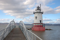 Tarrytown Lighthouse and footbridge connecting to shore, on the Hudson River near the village of Sleepy Hollow, New York.