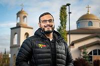 UAA Civil Engineering Alum Andrés Felipe Ruiz, now a staff engineer for R&M Consultants, photographed outside Holy Transfiguration Greek Orthodox Church.