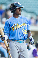 Lewis Brinson (32) of the Myrtle Beach Pelicans steps out of the batter's box during the game against the Winston-Salem Dash at BB&T Ballpark on July 16, 2014 in Winston-Salem, North Carolina.  The Pelicans defeated the Dash 6-2.   (Brian Westerholt/Four Seam Images)