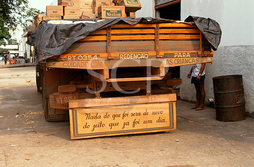 Redencao, Brazil. Amazon truck with sign on mudflap.