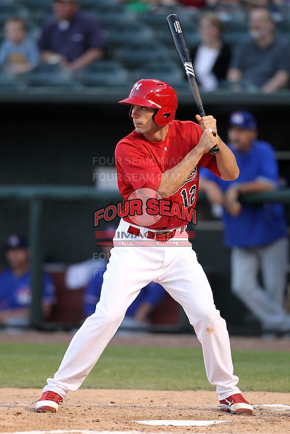 Memphis Redbirds third baseman Matt Carpenter #12 at bat during a game versus the Round Rock Express at Autozone Park on April 29, 2011 in Memphis, Tennessee.  Round Rock defeated Memphis by the score of 5-4 in 13 innings.  Photo By Mike Janes/Four Seam Images