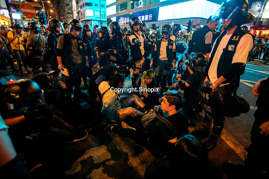 Anti-Extradition Bill protestors are arrested by police for 'unloawful assembly' during a road occupation in Mong Kok, Kowloon, Hong Kong, China, 04 August 2019.