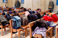 Bags & backpacks on pews during State Junior school visit to Guildford Cathedral..