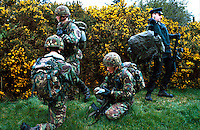 British Army soldiers and an R.U.C. officer on armed foot patrol in the countryside of Northern Ireland. The soldiers are wearing camoflage paint to help them blend into the background. This image may only be used to portray the subject in a positive manner..©shoutpictures.com..john@shoutpictures.com