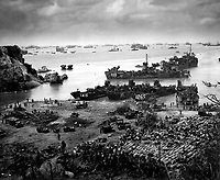 A formidable task force carves out a beachhead, about 350 miles from the Japanese mainland.  Landing craft of all kinds blacken the sea out to the horizon, where stand the battlewagons, cruisers and destroyers.  Okinawa, April 13, 1945.  (Coast Guard)<br /> NARA FILE #:  026-G-4426<br /> WAR & CONFLICT BOOK #:  1226
