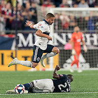FOXBOROUGH, MA - JULY 18: Luis Caicedo #27 disrupts Lucas Venuto #7 dribble during a game between Vancouver Whitecaps and New England Revolution at Gillette Stadium on July 18, 2019 in Foxborough, Massachusetts.