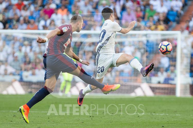 Eibar's Florian Lejeune and Real Madrid's Isco Alarcon during the match of La Liga between Real Madrid and SD Eibar at Santiago Bernabeu Stadium in Madrid. October 02, 2016. (ALTERPHOTOS/Rodrigo Jimenez)