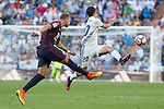 Eibar's Florian Lejeune and Real Madrid's Isco Alarcon during the match of La Liga between Real Madrid and SD Eibar at Santiago Bernabeu Stadium in Madrid. October 02, 2016. (ALTERPHOTOS/Rodrigo Jimenez)