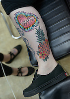 Two examples of Brie Felts's work on Valerie Gunther's leg Primal Instinct Tattoo. Photo by James R. Evans