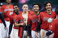 Jonathan Embry (second from left) had his jersey ripped off him by teammates after his walk-off hit against the Augusta GreenJackets at Joseph P. Riley, Jr. Park on June 25, 2021 in Charleston, South Carolina. (Brian Westerholt/Four Seam Images)