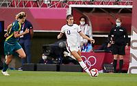 KASHIMA, JAPAN - JULY 27: Alex Morgan #13 of the United States moves with the ball during a game between Australia and USWNT at Ibaraki Kashima Stadium on July 27, 2021 in Kashima, Japan.