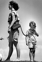 A telephone that walks; Melody Callan is put on hold as 5-year-old Allan Pillip checks in with his mother at home.<br /> <br /> Photo : Boris Spremo - Toronto Star archives - AQP