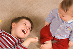 7 month old baby boy with 3 year old brother, laughing together