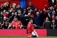 Alexis Sachez of Manchester United celebrates scoring his sides second goal  during the Premier League match between Manchester United and Swansea City at the Old Trafford, Manchester, England, UK. Saturday 31 March 2018