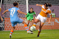 Atlanta Beat goalkeeper Alli Lipsher (18) watches teammate Cat Whitehill (4) and Casey Nogueira (27) of Sky Blue FC battle for the ball. Sky Blue FC defeated the Atlanta Beat 3-0 during a Women's Professional Soccer (WPS) match at Yurcak Field in Piscataway, NJ, on May 21, 2011.