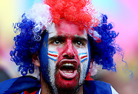 A Costa Rica fan cheers his side on