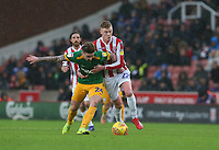 Preston North End's Sean Maguire is tackled by Stoke City's Sam Clucas<br /> <br /> Photographer Stephen White/CameraSport<br /> <br /> The EFL Sky Bet Championship - Stoke City v Preston North End - Saturday 26th January 2019 - bet365 Stadium - Stoke-on-Trent<br /> <br /> World Copyright © 2019 CameraSport. All rights reserved. 43 Linden Ave. Countesthorpe. Leicester. England. LE8 5PG - Tel: +44 (0) 116 277 4147 - admin@camerasport.com - www.camerasport.com